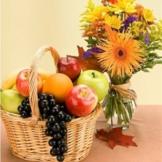 Image of Basket of fruit and spring flowers